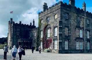 ripley castle with clients in the foreground