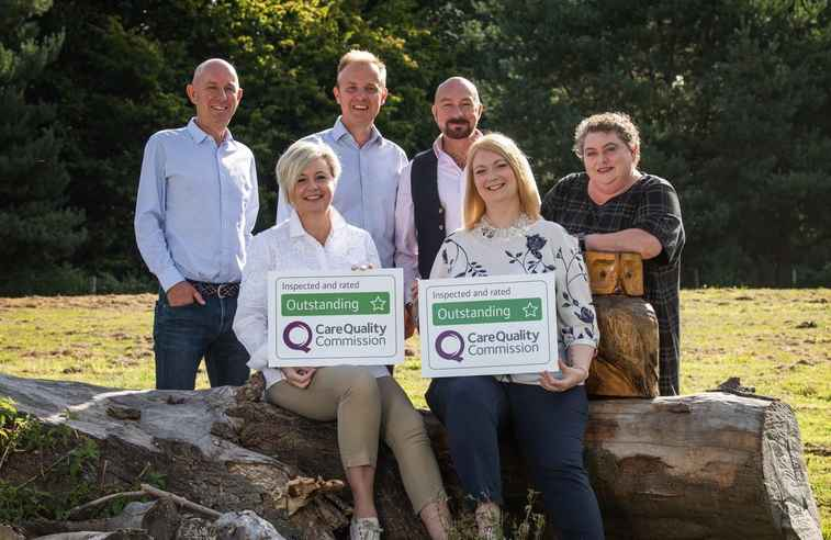 Photo of Home Instead Maidstone team with CQC Outstanding sign