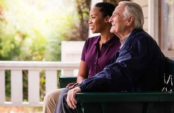 Client and CAREGiver sitting outside together