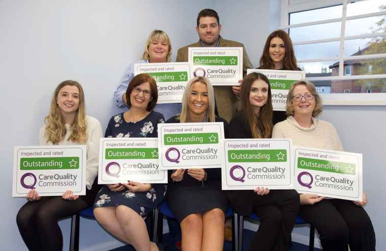 Home Instead West Norfolk team with CQC Outstanding signs