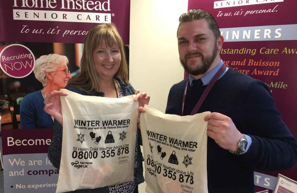 David and Karen Kenny of Age UK MidMersey with the Winter Warmers packs