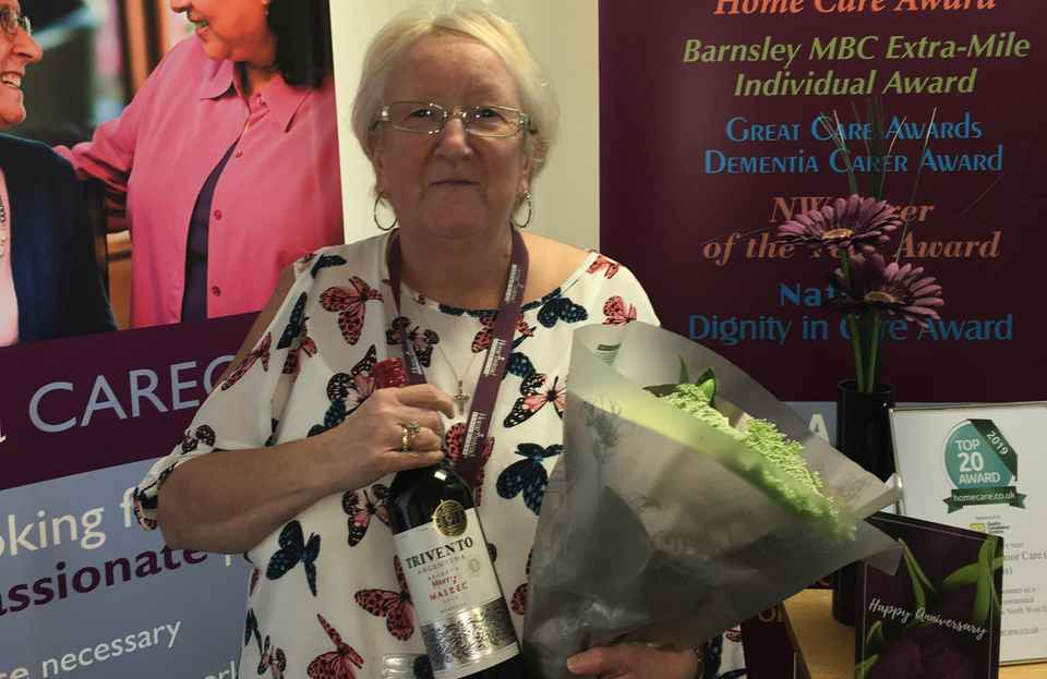 Marie celebrating 7 years as a Home Instead St Helens CAREGiver