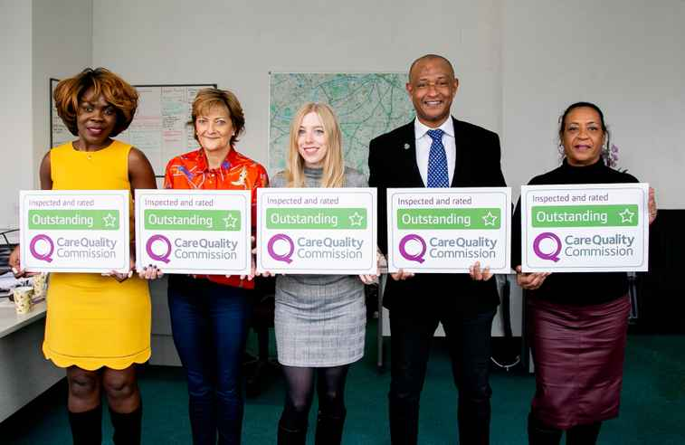 Home Instead Wandsworth team with CQC outstanding signs