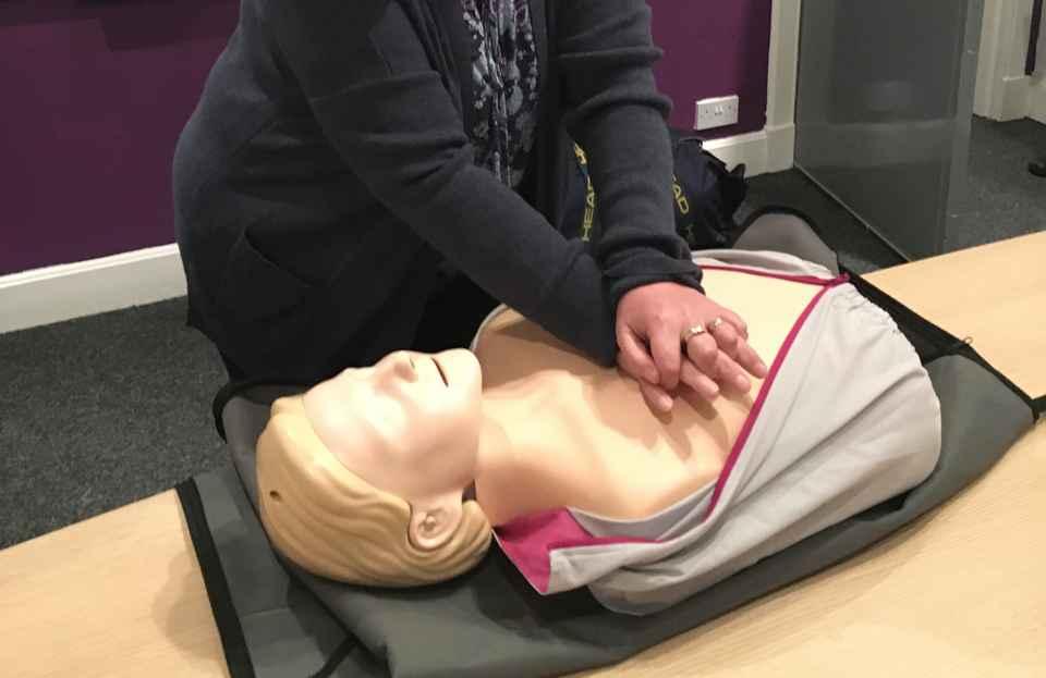 Caregiver practising CPR
