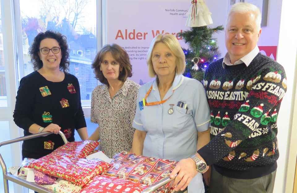 Home Instead staff delivering presents at Norwich Community Hospital
