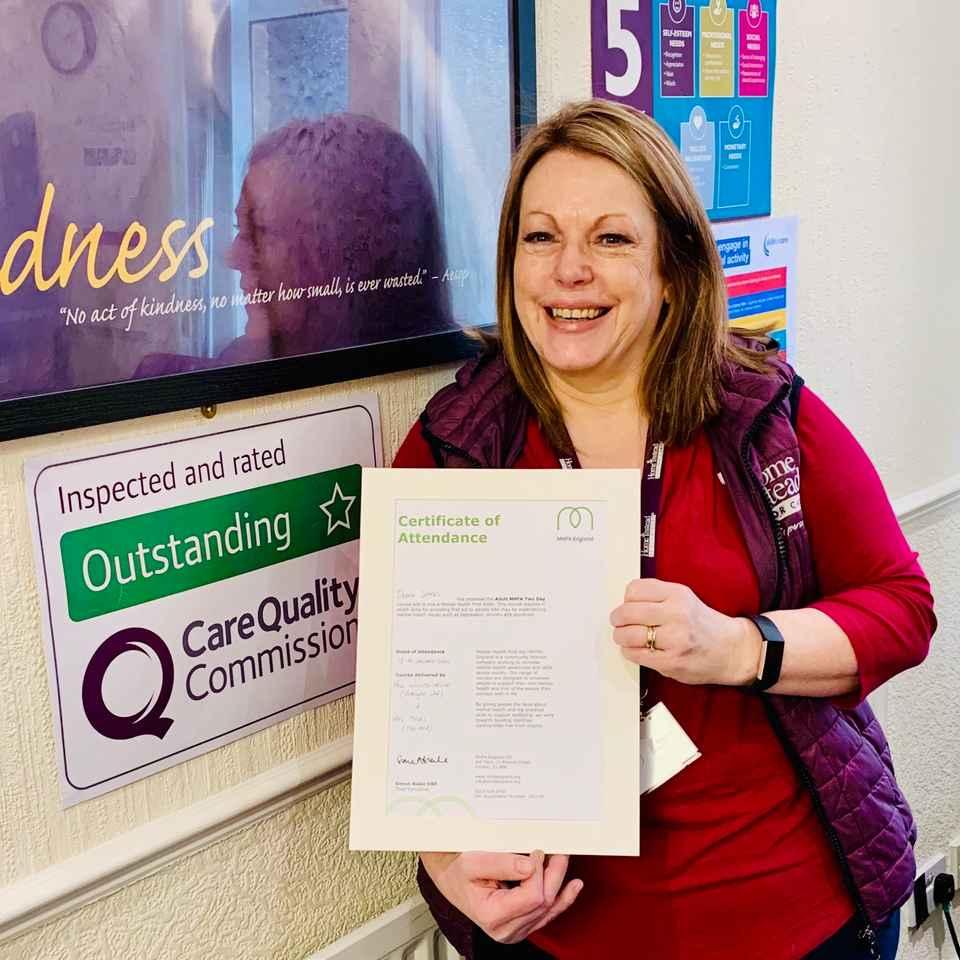 Debra with her MHFA Certificate