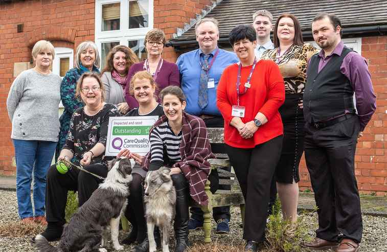 Home Instead Shrewsbury team with CQC Outstanding sign