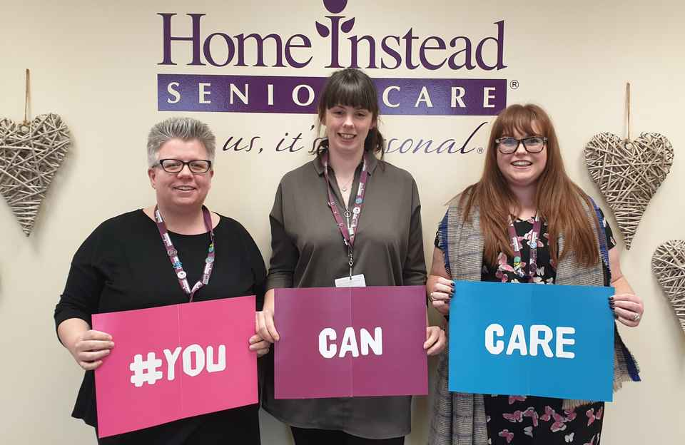 Office staff celebrating You Can Care Week