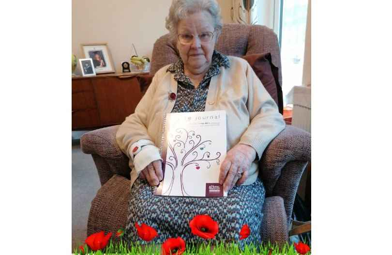 client with her memory journal