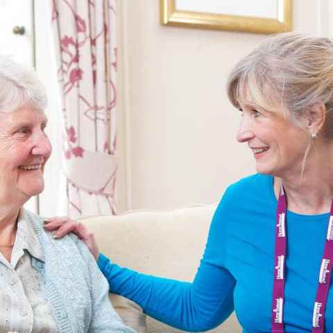 Live-in carer explaining to client about live-in care